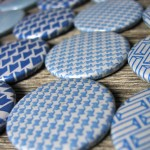 Badges made from recycled envelopes