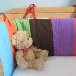 Technicolour Cot Bumper made from tea towels