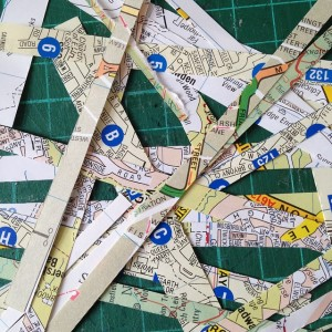 Scraps of maps left over from making eco notepads with map covers