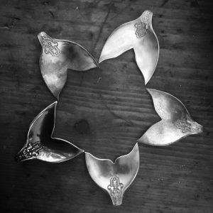 Unique, handcrafted whale tail pendants made in Kinghorn from rare and recycled silver