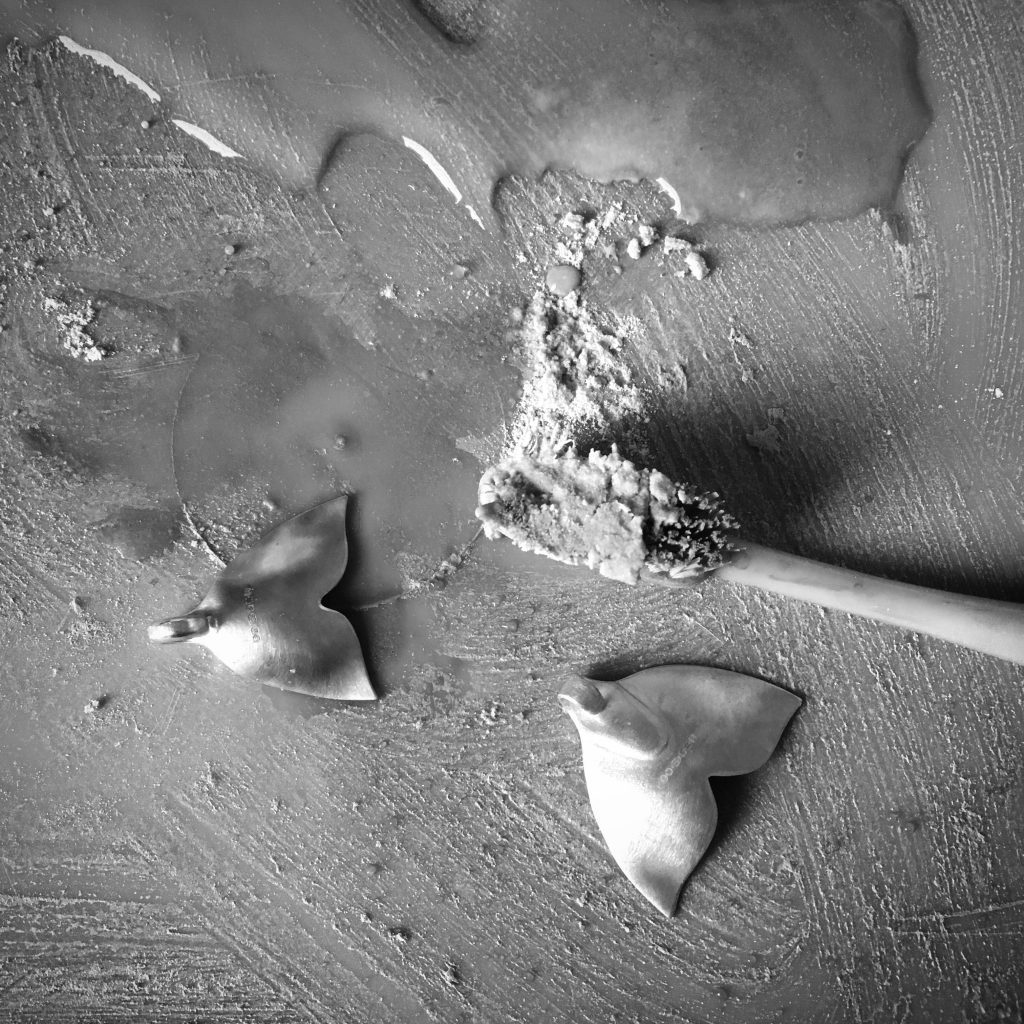 Making whale tail necklet from recycled sterling silver teaspoons in my studio in Kinghorn, Fife