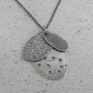 Unique, handcrafted Seashore Pendant made in Scotland from rare and recycled silver