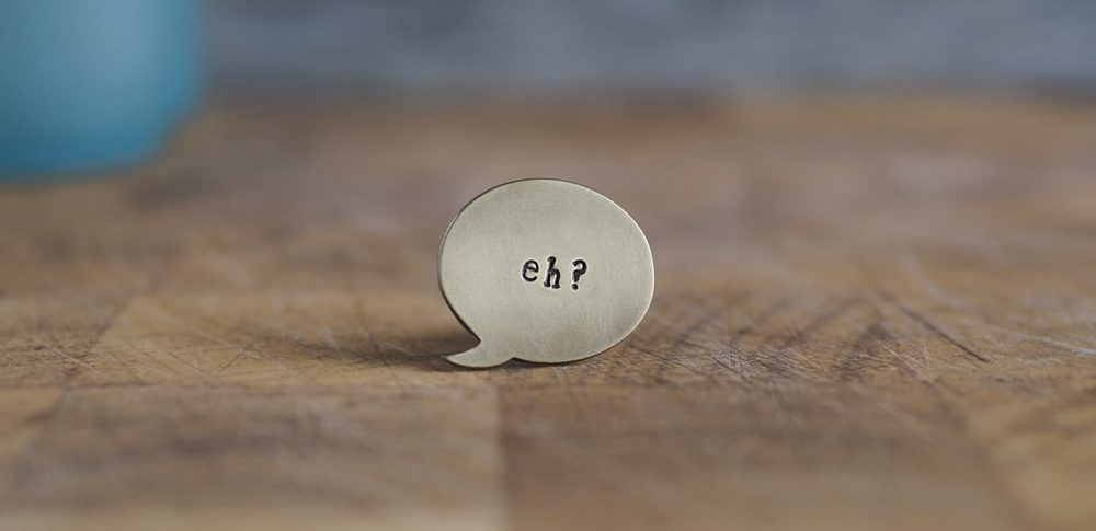 Top Brass Lapel Pin Say it like it is... eh?