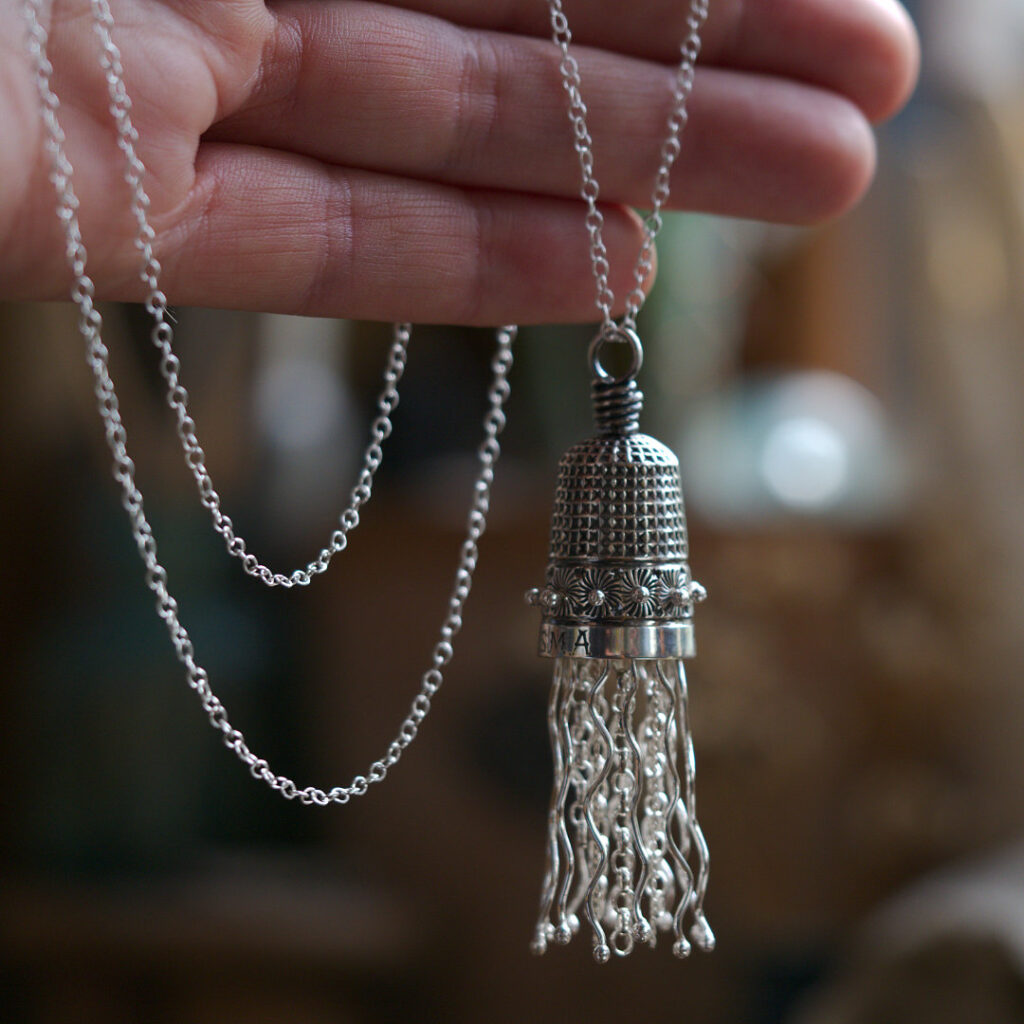 Milomade Jellyfish Pendant made from an antique sterling silver thimble